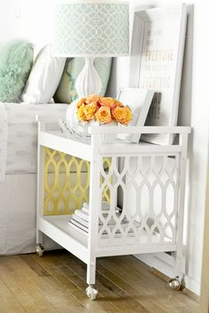 Use a bar cart as a bedside table in the guest bedroom. Easily rolls away when we need to fold out the daybed!