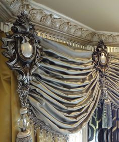 Ruched window valance in bay window. Pretty crown moulding.