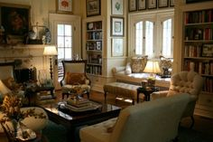 Warm and cozy...window seat, bookcases, art, great furniture around the fireplace, color combination