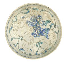 AN IMPORTANT KASHAN MINA'I AND LUSTRE BOWL DEPICTING A FALCONER ON HORSEBACK SIGNED BY THE ARTIST MUQRI, PERSIA, AD 1200-1220