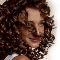 Cortes bonitos para el pelo rizado oscuro
