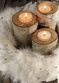 White Peacock Feather Wreath & birch candleholders.