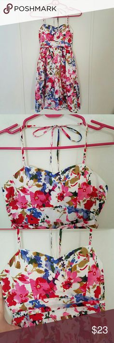 Forever 21 Gorgeous Floral Halter Dress Forever 21 beautiful summer dress with a retro vibe to it!  White with gorgeous multi-color floral print (pink, red, blue, green and purple).  Sweetheart neckline and padded bust.  Zips up in back  and has a removable tie belt around waist with belt loops. Ties around neck (halter).  Flowy bottom.  This is a reposh, too small for me in the bust area.  Looks brand  new and is in perfect condition!  Hanger straps are gone but there are no flaws apart…