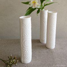(http://udessi.com.au/handmade-ceramics/decorative-objects-wall-pieces/amara-pattern-vintage-lace-porcelain-bud-vase-tall/)