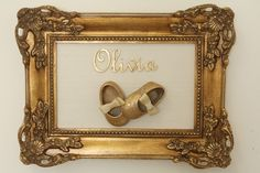 Everyone knows a Princess always loves her slippers! This DIY custom decor is such a cute idea for a pink princess themed nursery. Find an elegant frame and one of your baby girl's first pairs of shoes... spray paint them gold, and there you have a classy keepsake!