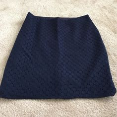 The Limited Navy Patterned Skirt Adorable skirt! Like new condition. Zips up the side and slit in the back. Measures 16.5in at the waist and length is 20.5in. 80% cotton, 20% nylon and lining is 100% polyester The Limited Skirts
