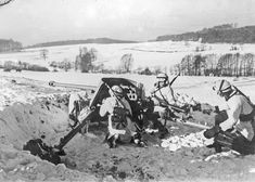 The artillerymen of the 50-mm PaK. 38 (5 cm PaK. 38) anti-tank gun from SS-Freiwilligen Division Galizien during the anti-guerrilla operation in Galicia (the territory approximately corresponding to Lviv, Ivano-Frankivsk and Ternopil regions of Ukraine ).