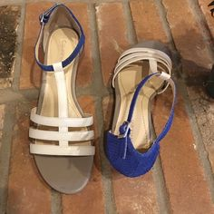 Calvin Klein white w/ royal blue heel wedges Never worn. Tried on in store. Low wedge in taupe, royal blue color pop on back and ankle strap, white t-strap. Calvin Klein Shoes Wedges