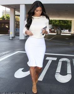 Walk this way: Kim, 33, looked as though she was sashaying down a runway as she went about her day on Monday