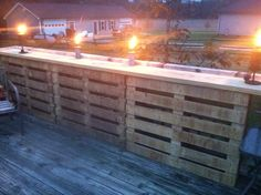 This was a quick throw together for a bar or table top eating area, I used 6 pallets and a 2x12x12 for the top. It also strengthened up the deck railing also. Planning on doing another portion of the deck later. Very happy with the outcome considering the pallets were free and the 2x12 was about $20 and a few screws.