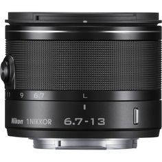 The black 1 NIKKOR VR Lens from Nikon is a compact wide-angle zoom lens compatible with all Nikon 1 cameras equipped with the Nikon 1 mount. Camera Shop, Camera Lens, System Camera, Chromatic Aberration, Zoom Lens, Best Camera, Focal Length, Color Correction, Aperture