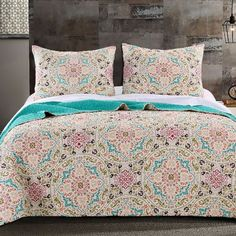 Moroccan Vintage Geometric Medallion Pattern Aqua 100-percent Cotton Quilt and Shams Set.   Features mandalas, circles, kaleidoscopes in soft colors.  Reversible to a solid aqua blue color for two look in one.