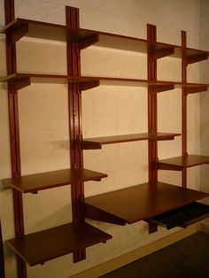 Oh, oh!!!  Adjustable, wall-mounted shelving that is all wood!  Happy day, happy day!!