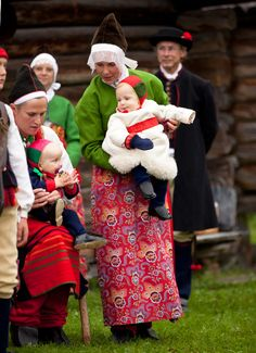 Boda. A sheepskin frock and knitted mittens and stockings keeps the baby warm during winter.