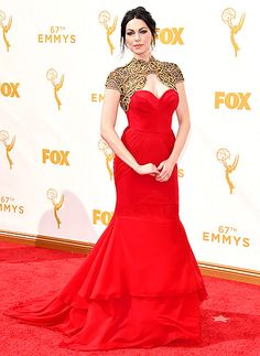Laura Prepon in a strapless red dress topped by a brocade shrug at the 2015 Emmy Awards. Read more: http://www.usmagazine.com/celebrity-style/pictures/emmy-awards-2015-red-carpet-fashion-2015189/47254#ixzz3maIfTYdQ Follow us: @usweekly on Twitter | usweekly on Facebook
