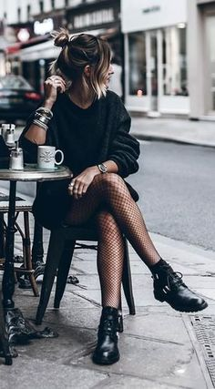 all black. street style. buckle boots.