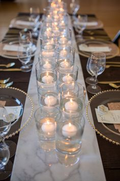 Cararra marble and hexagons with gold and blush pink wedding inspiration styled shoot at Flinn Block Hall wedding venue in Albany Oregon. Blush sequin napkins and table linens. Gold silverware with hexagon marble gold calligraphy place cards. Cararra marble runner with floating candles