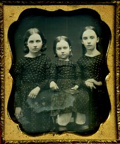 Three sisters in matching dresses.