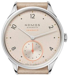 NOMOS Glashutte Minimatik Champagne timepiece is presented on a beige leather strap. The case encases a champagne gold dial with numeral hour markers and silver hands. This watch features a NOMOS calibre DUW 3001 automatic movement with a 43 hour Orange Highlights, Time And Tide, Watch One, Beautiful Watches, Automatic Watch, Cowhide Leather, Luxury Watches, Leather Case, Omega Watch