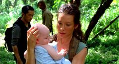"""4.12 """"There's No Place Like Home (Part 1)"""" – Jack and Kate meet Sawyer and Miles in the jungle. Sawyer is carrying Aaron, because he and Miles have been unable to find Claire. They talk, they disagree, (how unusual!) and Kate takes Aaron right before Jack and Sawyer continue on, following the helicopter signal. This is the moment that Kate becomes Aaron's guardian/mommy. JACK: Take care of the baby, okay?"""