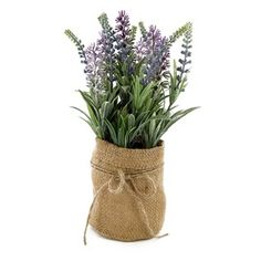 """Decorate your home or office with faux flowers! Lavender in Burlap Jar features an all-around arrangement of purple faux lavender and greenery in a short burlap jar with a burlap string embellishment. Place this beautiful arrangement on a mantle, table, desk, or other raised surface to give any room a touch of wildly delicate beauty.    Dimensions:      Length: 4""""    Width: 4""""    Height: 10 1/4"""""""
