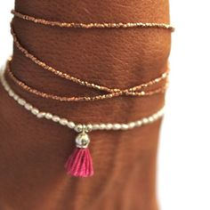 Vivien Frank http://vivienfrank.bigcartel.com/product/faceted-nugget-tassel-bracelet & http://vivienfrank.bigcartel.com/product/24k-rose-gold-vermeil-wrap-bracelet