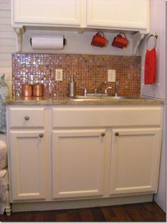 kitchen in Debra & Gary's 320 square foot cottage
