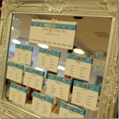 setting the table plan on a gilded ornate mirror.
