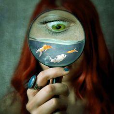 Fine Art Conceptual Photograph. Surreal photo, abstract, portrait, dark, water, fish, green eye