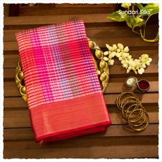 The essence of vibrant and vivid dreams that leave us longing for more, is perfectly encapsulated in our silk saree weave. This drape carries our hallmark body design with lines and colours used differently, making this a weave unlike no other.  #SundariSilks #EssenceOfIndia #Chennai #Mumbai #NationalHandloomWeek #SwadeshiMovement #HeritageOfHandlooms #WeavesOfIndia #TimelessTraditions #SundariSilksHandloomWeek #LegacyOfLooms #CraftsOfIndia #KanchipuramSilkSaree #WeavesOfKanchipuram Ethnic Sarees, Banarasi Sarees, Swadeshi Movement, Essence Of India, Mysore Silk Saree, Traditional Silk Saree, Designer Silk Sarees, Silk Sarees Online, Cotton Saree