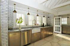 Billy Joel's Hamptons House stainless steel cabinets, subway tile, and stenciled wood floor Celebrity Kitchens, Celebrity Houses, Hgtv Kitchens, Cool Kitchens, Dream Kitchens, Billy Joel, White Brick Tiles, Stainless Steel Cabinets, Metal Cabinets