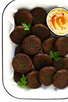 Learn how to make falafel with this easy homemade falafel recipe. It's bursting with zesty fresh fresh flavors, lightly pan-fried (instead of deep-fried), and perfect for falafel wraps, salads and other favorite dishes. Salsa Tzatziki, Tzatziki Sauce, Best Falafel Recipe, Fresh Herbs, Fresh Fresh, Hummus Platter, How To Make Falafel, Falafel Wrap, Gimme Some Oven