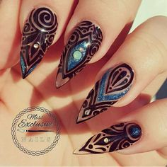 Stiletto nails with black and blur design