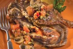 Soft-Shell Crab Basilica.    Marinated soft-shell crabs, pan fried and served with a white wine and stock sauce.