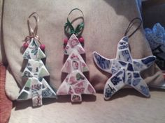2 christmas trees decorated with red and green sea pottery which is more difficult to find. Also a star fish with the popular blue sea pottery.