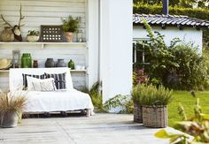 Cozy wicker sofa on the terrace.