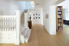 Like the few steps up and the depth of the hall, but the color palette is too weak in comparison to the flooring