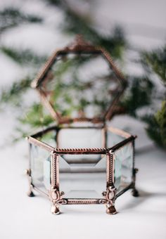 This is a little glass hexagon box for jewelry  Dimensions Height: 5 cm (2'') Width: 7 cm (2,7'') Length: 8 cm (3,2'') metal color; copper Stained glass small rectangular box that will suit for the wedding ceremony as a stand under wedding rings and later on will serve as a wonderful reminder of that beautiful day. This hand-made casket is created with love and passion and is also a perfect interior adornment. Great choice as a gift to the person or people you really care about.  It's…