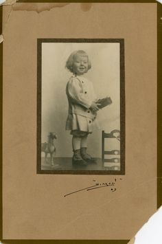 Vintage Photo Little Boy Holding Toy Cabinet by foundphotogallery