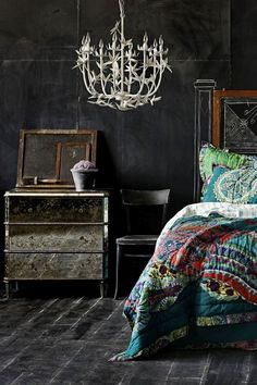Love the dark flooring. I also like the very bohemian bed covers to add some color.