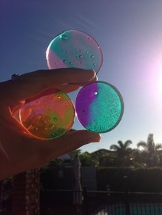 Making colored disks for wind chimes, jewelry or other projects using plastic shot glasses