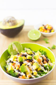 This Quinoa and Black Bean Burrito Bowl is such a quick and easy meal that is deliciously nutritious, filling and topped with a creamy chipotle dressing!