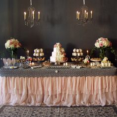 Grey lace with pink chiffon table skirt. Simple and cute sweets table.