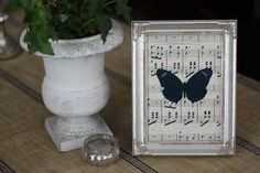 Butterfly on Vintage Sheet Music Print by UponADreamDesigns