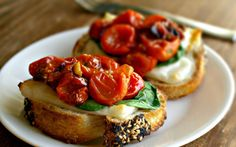 <p>These toasts contain three delicious layers: melty mozzarella cheese, wilted spinach, and garlicky grape tomatoes.</p>