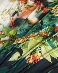 A medium-weight polyester jersey fabric with a stunning digital floral panel print. Featuring a large Oriental inspired floral design with orchid, camellia, honey suckle and sweet pea on a white and dark ink blue background. This fabric has a beautiful draping quality and shimmer appearance. Ideal for occasion wear such as slinky dresses and tops.  Get it now: http://www.trurofabrics.com//polyester-jersey-fabric-digital-oriental-floral-print.html