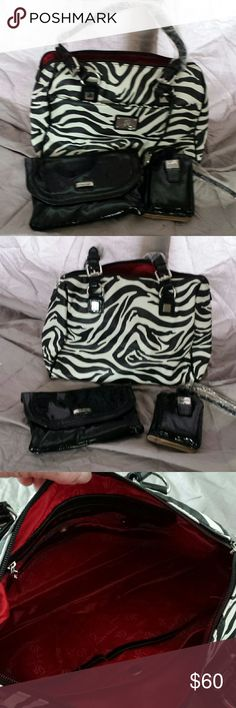 Grace Adele handbag Zebra print Grace Adele handbag with a black clutch and small black credit card case.  Bag has lots of compartments for organization. Grace Adele Bags Shoulder Bags