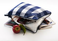 The Hastens Store Dallas offering Hastens Travel Pillow: Ideal for traveling with its reversible design. Zip it up with your passport and loose items with the rugged blue check fabric out. Then when you have settled in to your seat for your long trip, reverse the pillow to expose the soft cotton and down interior. Website: http://www.mydreambeds.com