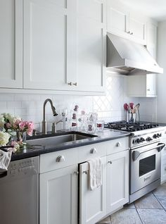 Lilly Bunn Interior - kitchens - white, shaker, kitchen cabinets, brushed nickel, pulls, hardware, black, granite, countertops, herringbone, pattern, subway tiles, backsplash, shaker cabinets, white shaker cabinets,