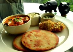 Dana-Jamarua Thali  Special Bihari aubergine and potato based dish served with rice-based rotis stuffed with spinach and aubergine mash.